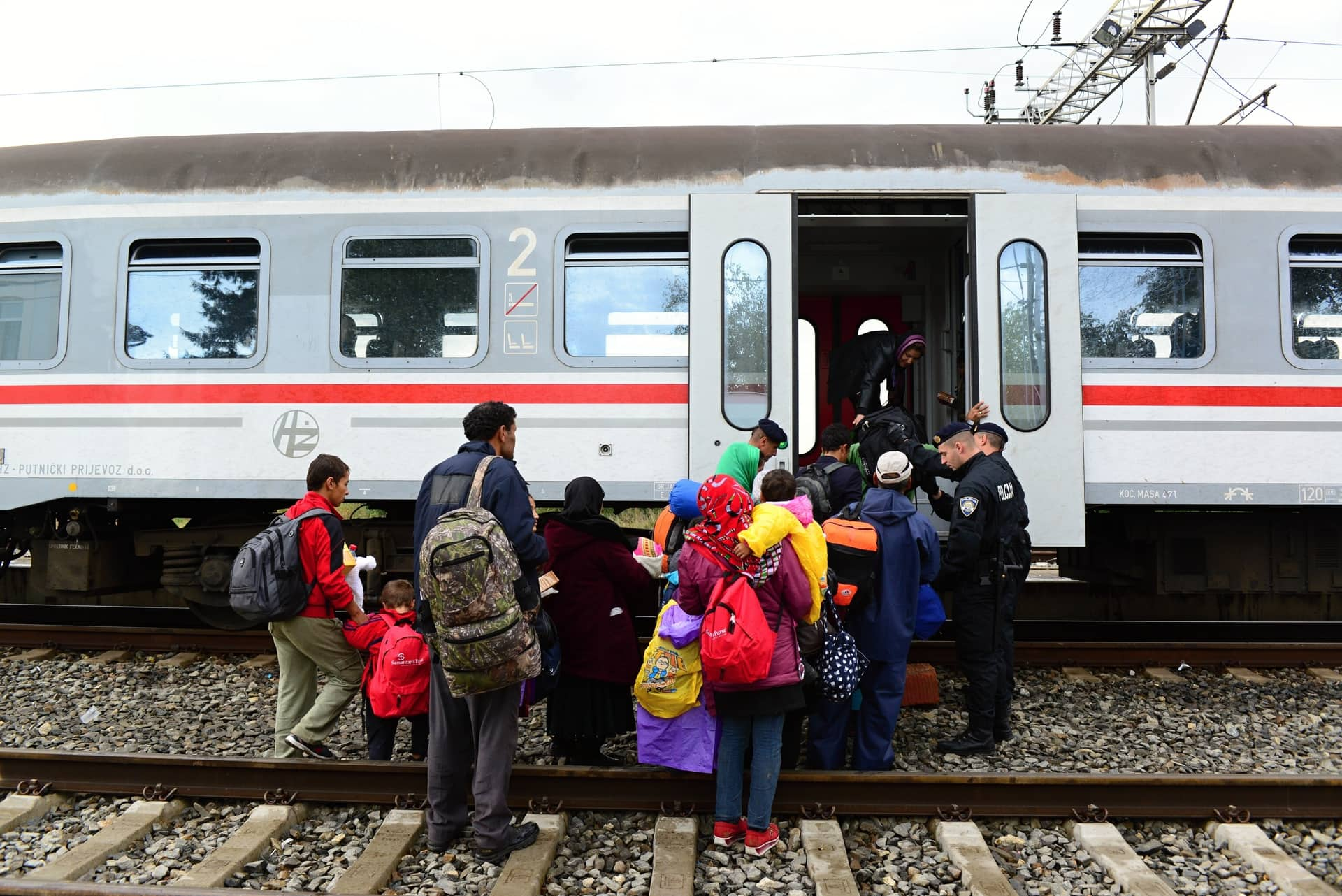October 5 2015; Tovarnik in Croatia. Croatian police assist refugees get into train which will go to Hungary.October 5 2015; Tovarnik in Croatia.