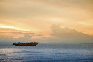 Sunset behind a refugee boat on Lake Tanganyika